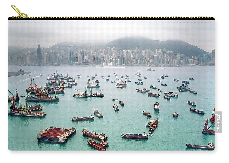 Trading Carry-all Pouch featuring the photograph A View Of Hong Kong Harbor Through A by Xpacifica