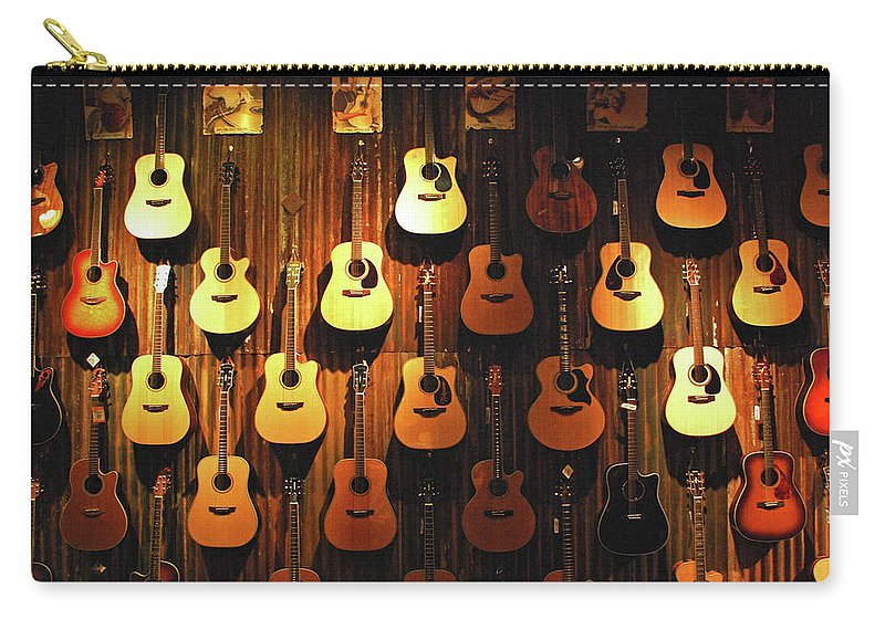 Hanging Carry-all Pouch featuring the photograph Acoustic Guitars On A Wall by Karas Cahill Photography