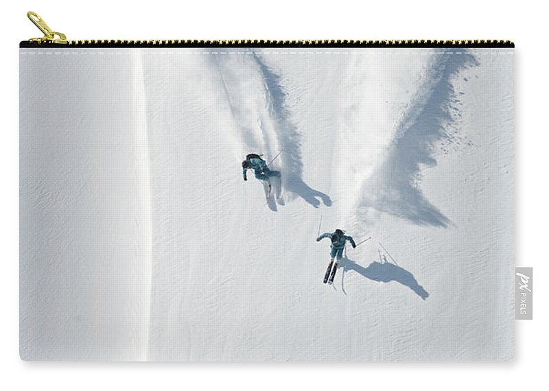 Crash Helmet Carry-all Pouch featuring the photograph Aerial View Of Two Skiers Skiing by Creativaimage
