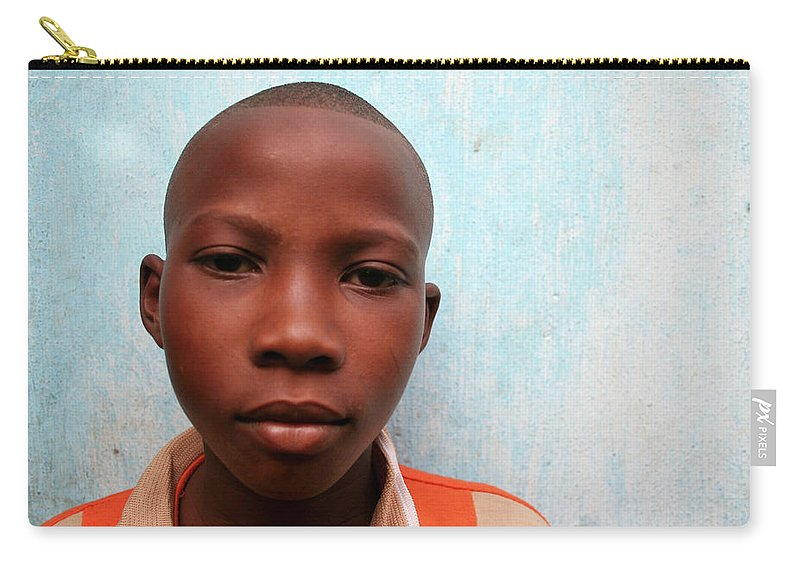 Education Carry-all Pouch featuring the photograph African Boy by Peeterv