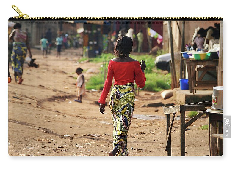 Trading Carry-all Pouch featuring the photograph African Street Scene by Peeterv