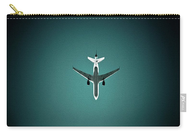 Outdoors Carry-all Pouch featuring the photograph Airplane Silhouette by Miikka S Luotio