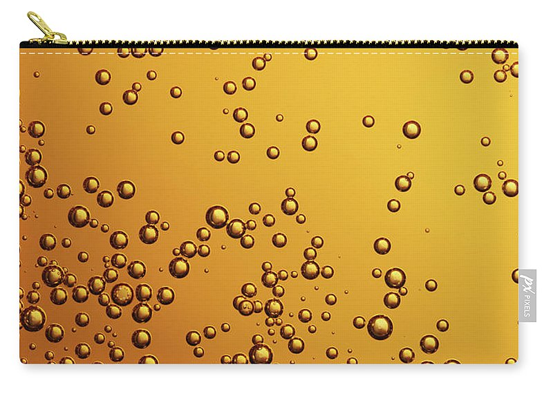 Alcohol Carry-all Pouch featuring the photograph Amber Colored Carbonated Bubbles by Burwellphotography