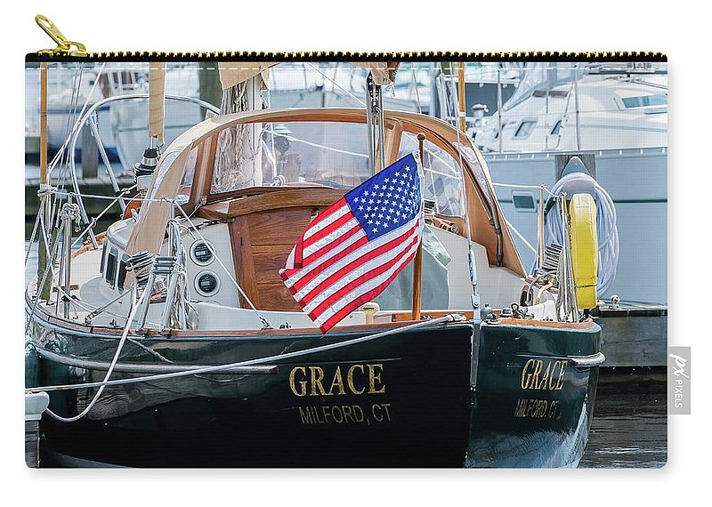 Boat Carry-all Pouch featuring the photograph American Pride At The Marina by Kaitlyn Casso
