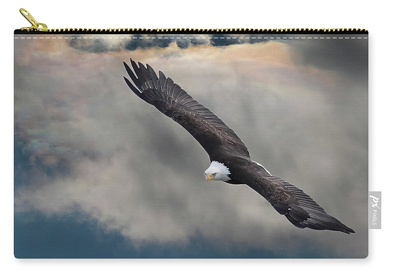 Bird Of Prey Carry-all Pouch featuring the photograph An Eagle In Flight Rising Above The by Design Pics / Robert Bartow