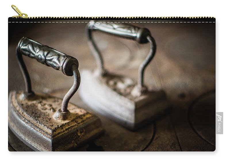 Two Objects Carry-all Pouch featuring the photograph Antique Irons by Jimss