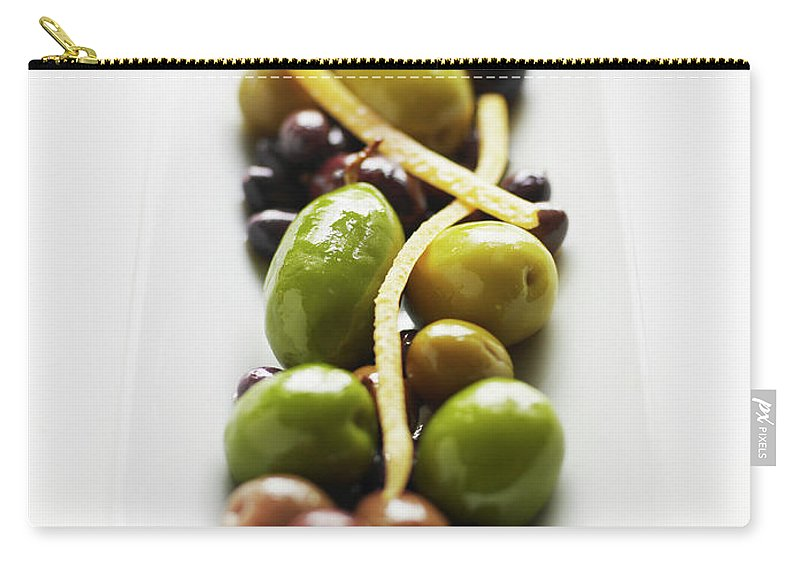 White Background Carry-all Pouch featuring the photograph Appetizer Of Warm Marinated Olives by Thomas Barwick