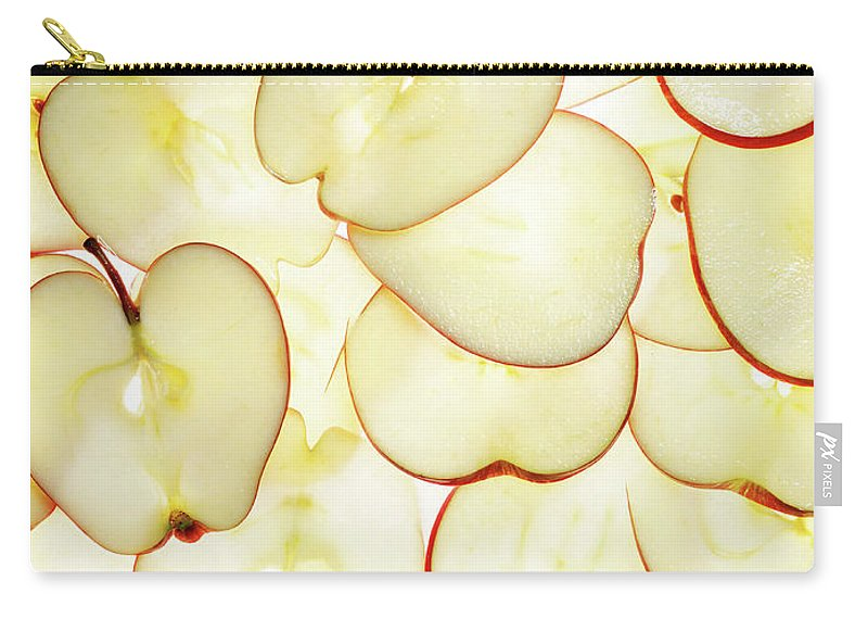 Large Group Of Objects Carry-all Pouch featuring the photograph Apple Slices by Lauren Burke