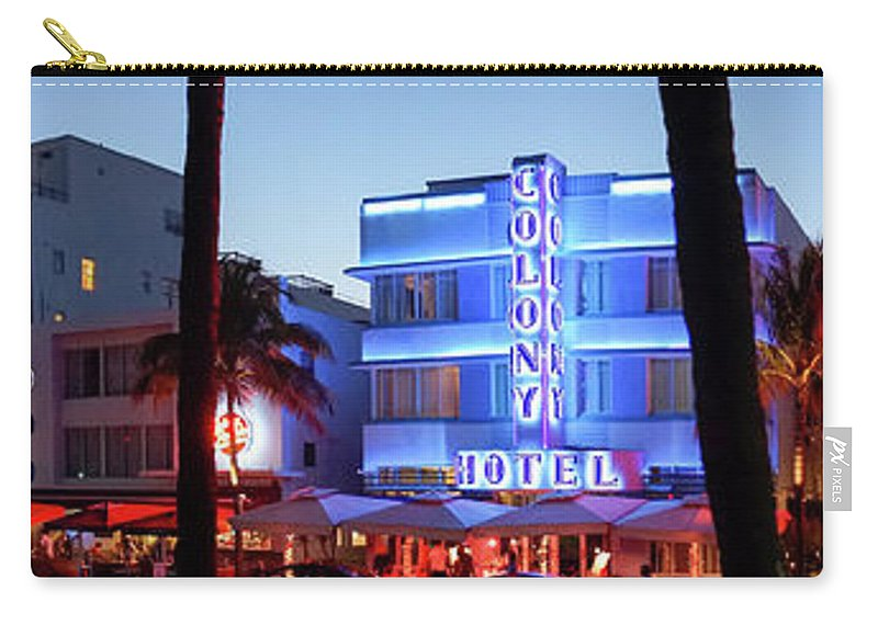 Panoramic Carry-all Pouch featuring the photograph Art Deco Hotels On Ocean Drive At Dusk by Buena Vista Images