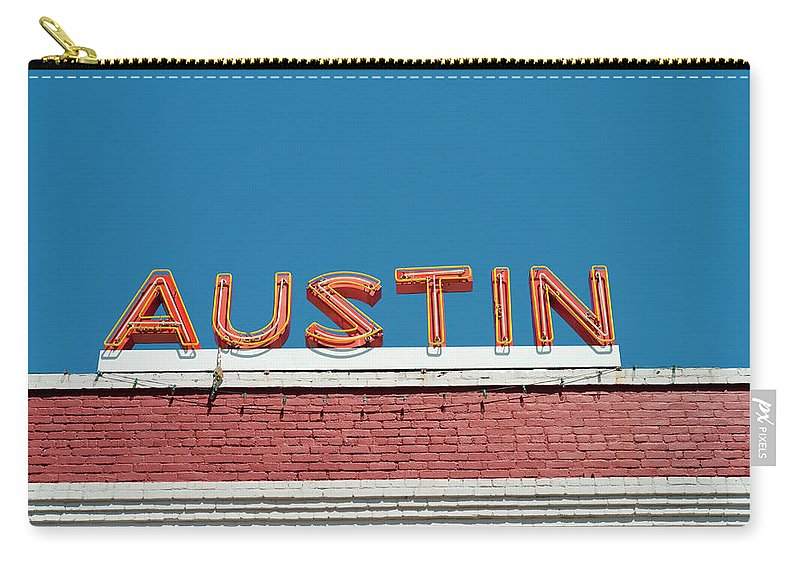 Sunlight Carry-all Pouch featuring the photograph Austin Neon Sign by Austinartist