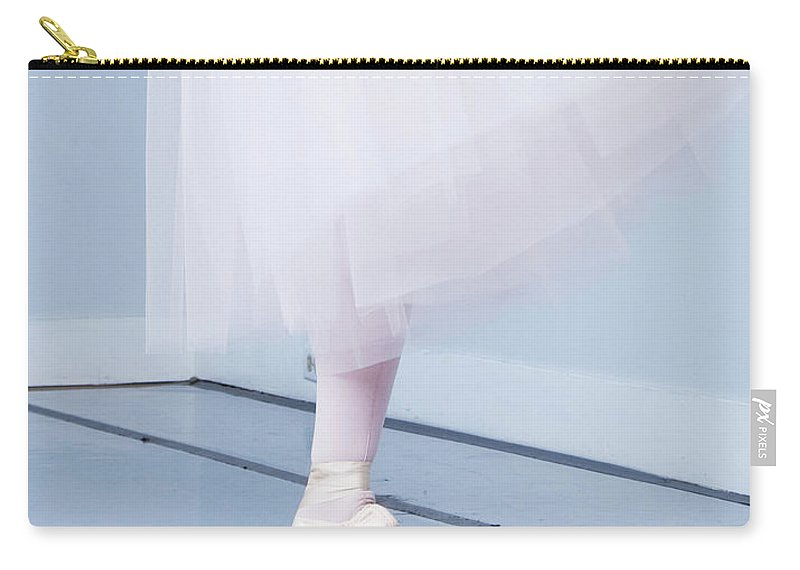 Expertise Carry-all Pouch featuring the photograph Ballerina On Pointe Low Angle View by Jonya