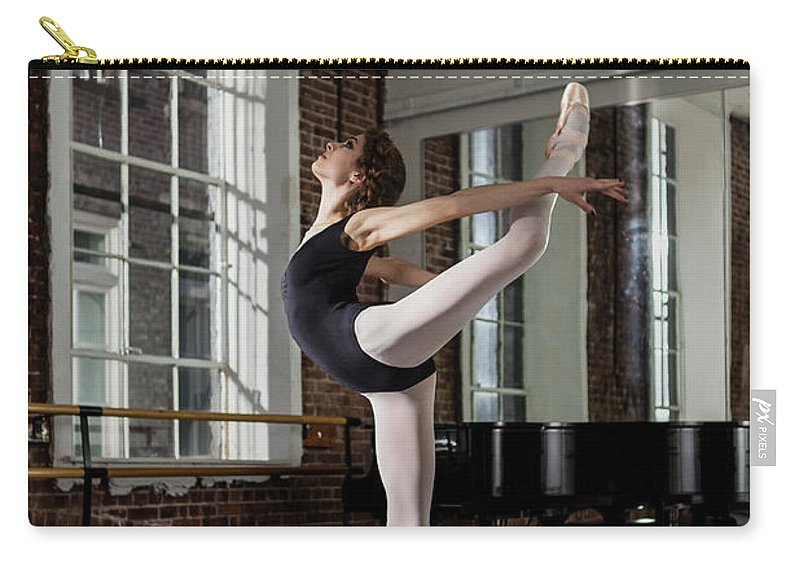 Ballet Dancer Carry-all Pouch featuring the photograph Ballerina Performing Attitude In Dance by Nisian Hughes