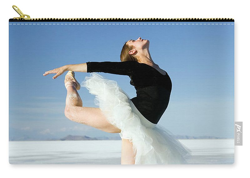 Ballet Dancer Carry-all Pouch featuring the photograph Ballerina Tip Toe Pose by Avid creative