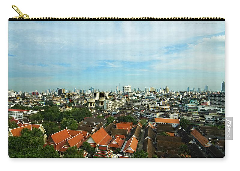 Tropical Tree Carry-all Pouch featuring the photograph Bangkok View With Temple Roofs 2 by Sndrk