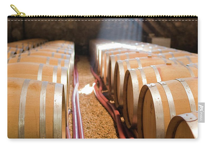 Alcohol Carry-all Pouch featuring the photograph Barrels In Wine Cellar by Johner Images