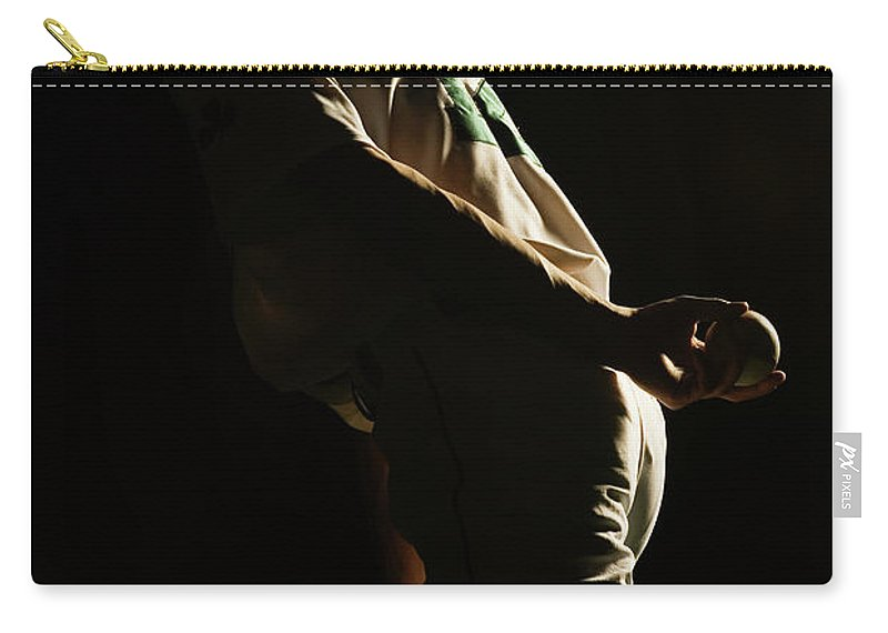Three Quarter Length Carry-all Pouch featuring the photograph Baseball Pitcher Holding Ball Behind by Pm Images