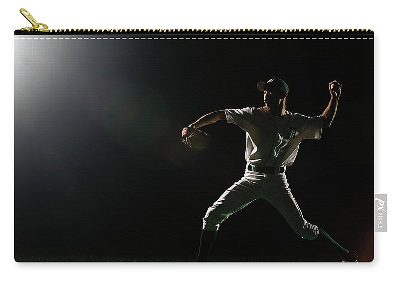 Human Arm Carry-all Pouch featuring the photograph Baseball Pitcher Releasing Ball by Pm Images
