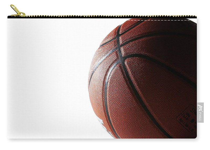 Recreational Pursuit Carry-all Pouch featuring the photograph Basketball On White Background by Thomas Northcut