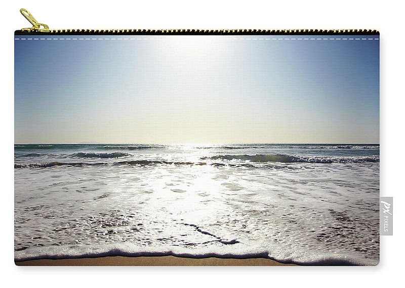 Tranquility Carry-all Pouch featuring the photograph Beach In California On Pacific Ocean by Thomas Northcut