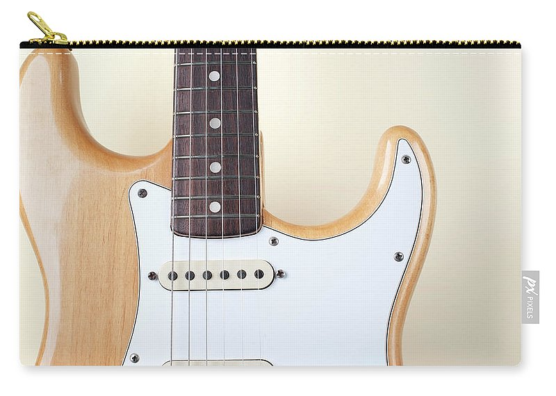 Rock Music Carry-all Pouch featuring the photograph Beige Wood Textured Electric Guitar by Neyya