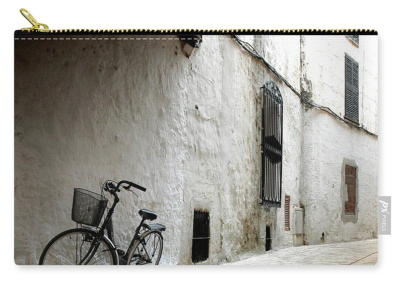 Tranquility Carry-all Pouch featuring the photograph Bicycle Leaning Wall by Antonio R. Ramos