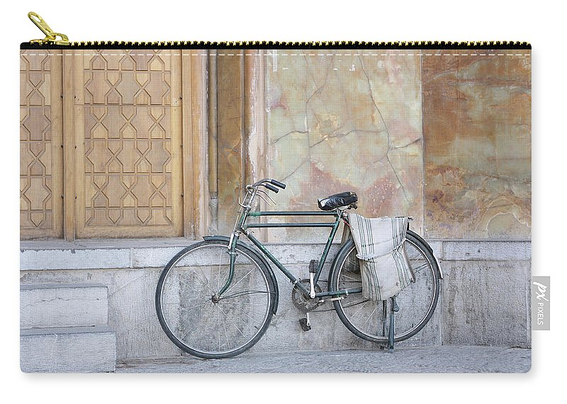 Tranquility Carry-all Pouch featuring the photograph Bicycle Outside The Imam Mosque by 717images By Paul Wood