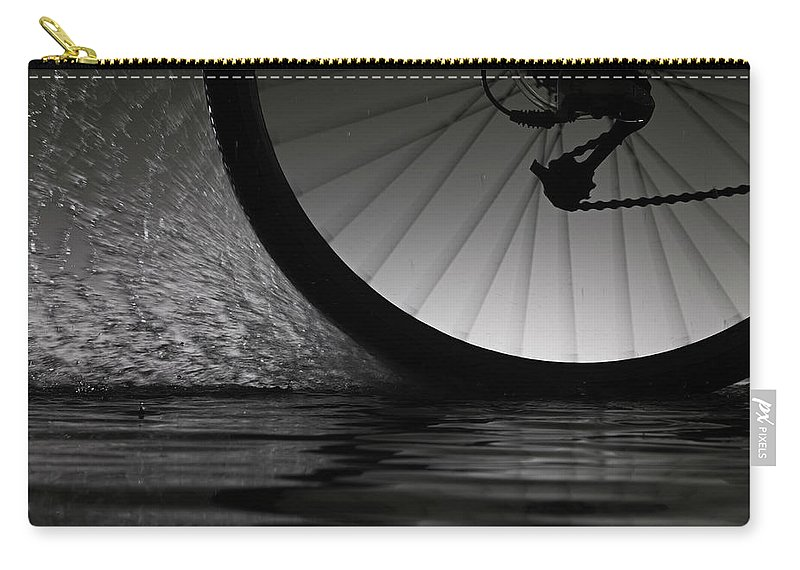 Recreational Pursuit Carry-all Pouch featuring the photograph Bike Riding Through Water by Jonathan Knowles