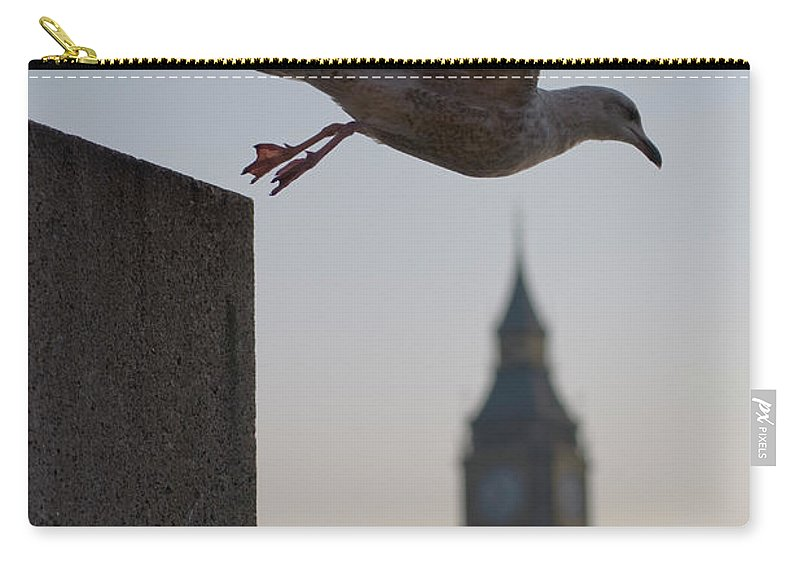 Clock Tower Carry-all Pouch featuring the photograph Bird Takeoff by Photograph © Jon Cartwright