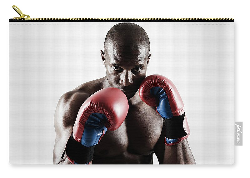 People Carry-all Pouch featuring the photograph Black Male Boxer In Boxing Stance by Mike Harrington
