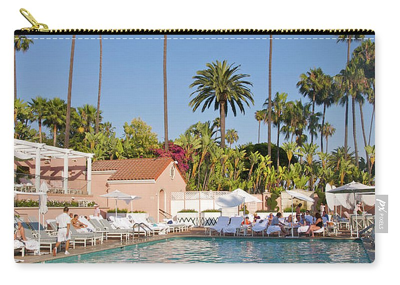 Tranquility Carry-all Pouch featuring the photograph Blue-bottomed Pool Beneath Palm Trees by Barry Winiker