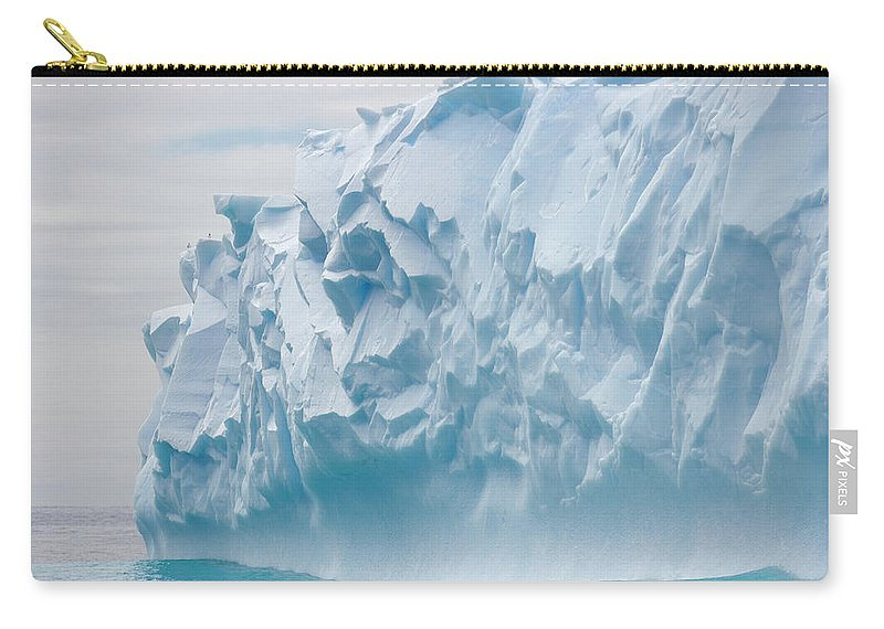 Scenics Carry-all Pouch featuring the photograph Blue Iceberg Carved By Waves Floats In by Eastcott Momatiuk