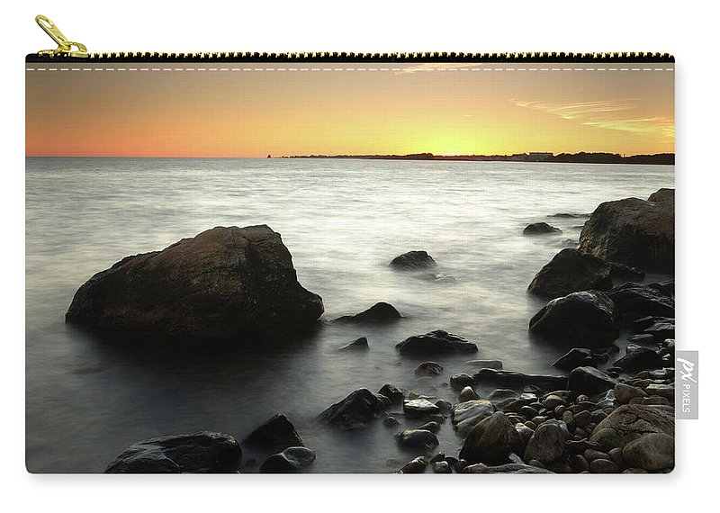 Water's Edge Carry-all Pouch featuring the photograph Bluff Point Sunset by Ericfoltz