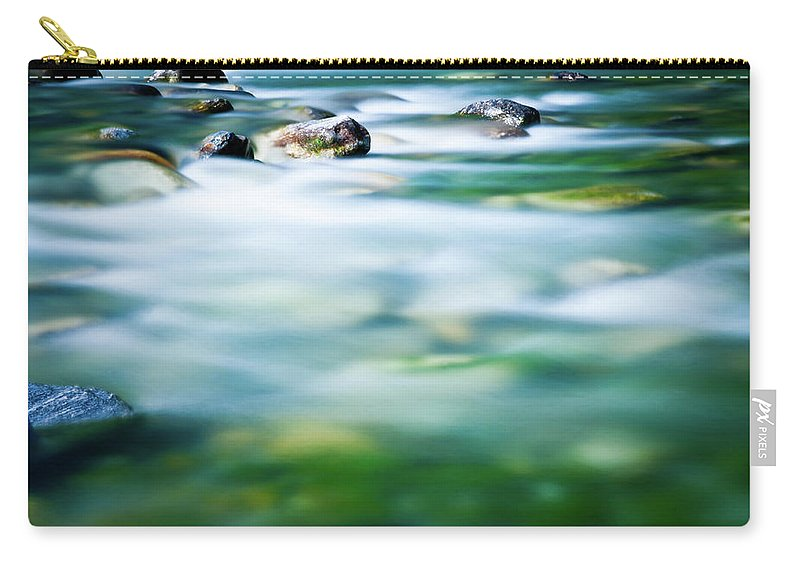 Scenics Carry-all Pouch featuring the photograph Blurred River by Assalve