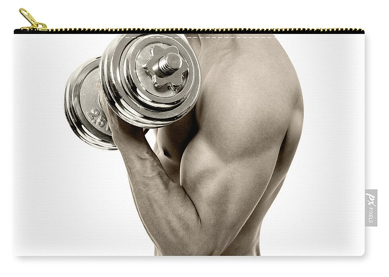 Young Men Carry-all Pouch featuring the photograph Body Builder Exercising by Gilaxia