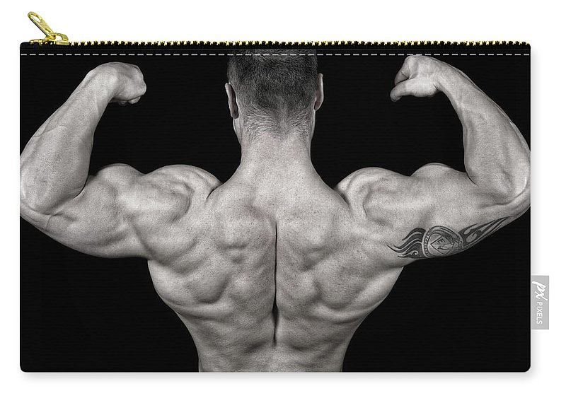 Toughness Carry-all Pouch featuring the photograph Bodybuilder Posing by Vuk8691