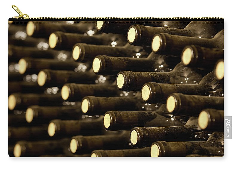 Stellenbosch Carry-all Pouch featuring the photograph Bottled Red Wine Aging In Wine Cellar by Siegfried Layda