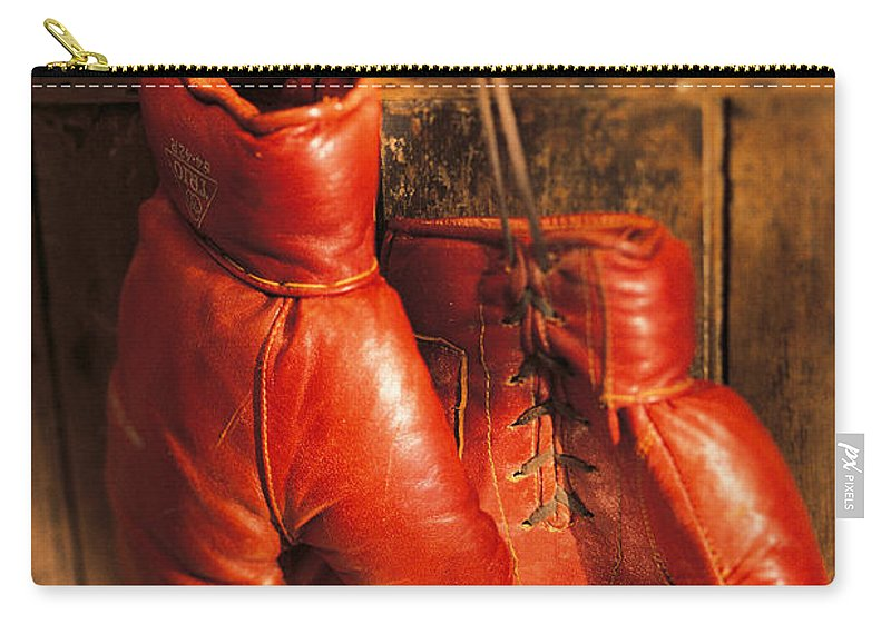 Hanging Carry-all Pouch featuring the photograph Boxing Gloves Hanging On Rustic Wooden by Comstock