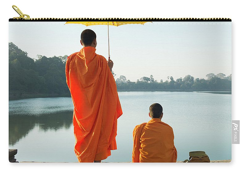 Young Men Carry-all Pouch featuring the photograph Buddhist Monks Standing In Front Of by Martin Puddy