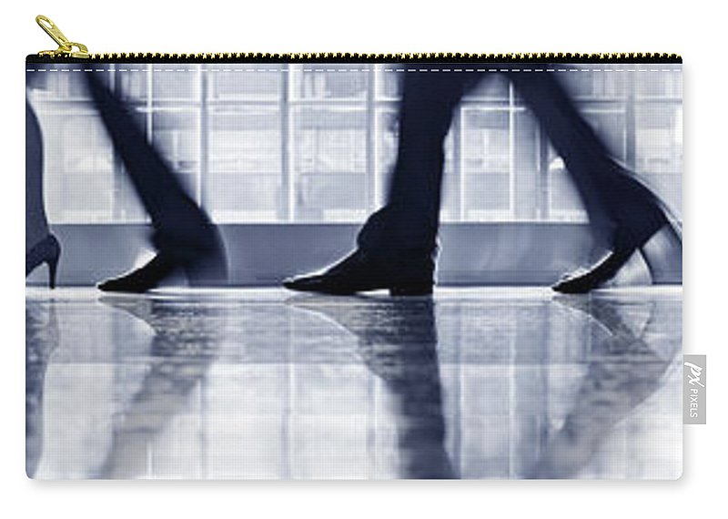 Corporate Business Carry-all Pouch featuring the photograph Businesspeople Walking In Lobby, Low by Poba