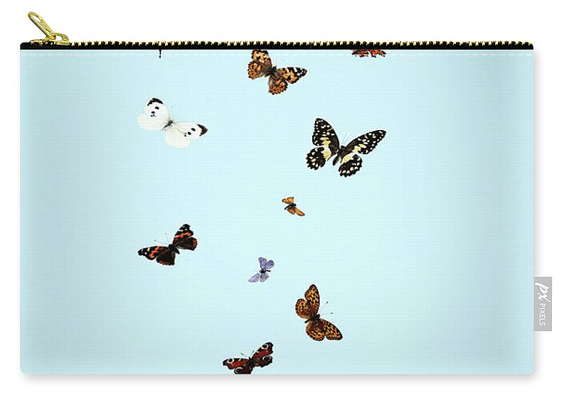 Animal Themes Carry-all Pouch featuring the photograph Butterflies Escaping From Jar by Martin Poole