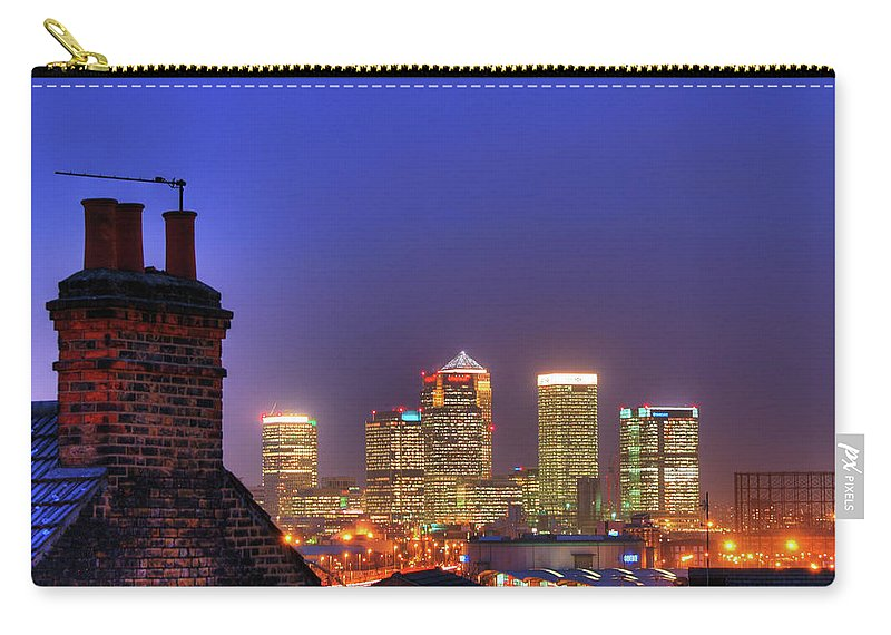 Clear Sky Carry-all Pouch featuring the photograph Canary Wharf by Andy Linden