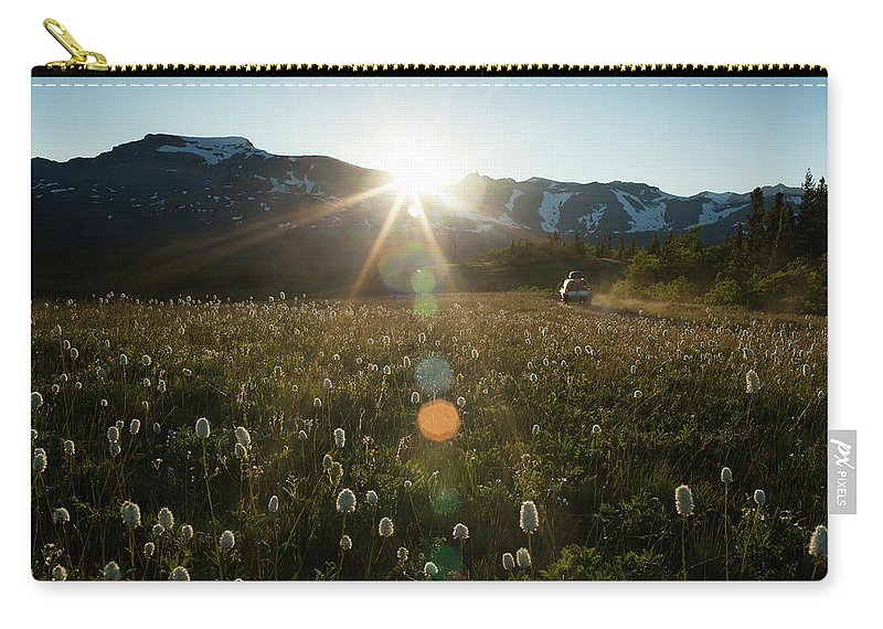 Scenics Carry-all Pouch featuring the photograph Car On Rural Dirt Road In Mountains At by Noah Clayton