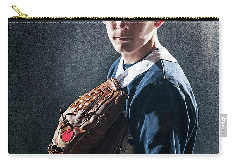 Baseball Cap Carry-all Pouch featuring the photograph Caucasian Baseball Player Standing by Erik Isakson