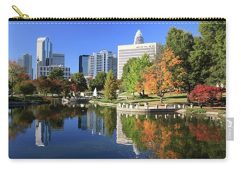 North Carolina Carry-all Pouch featuring the photograph Charlotte Skyline And Pond, North by Jumper