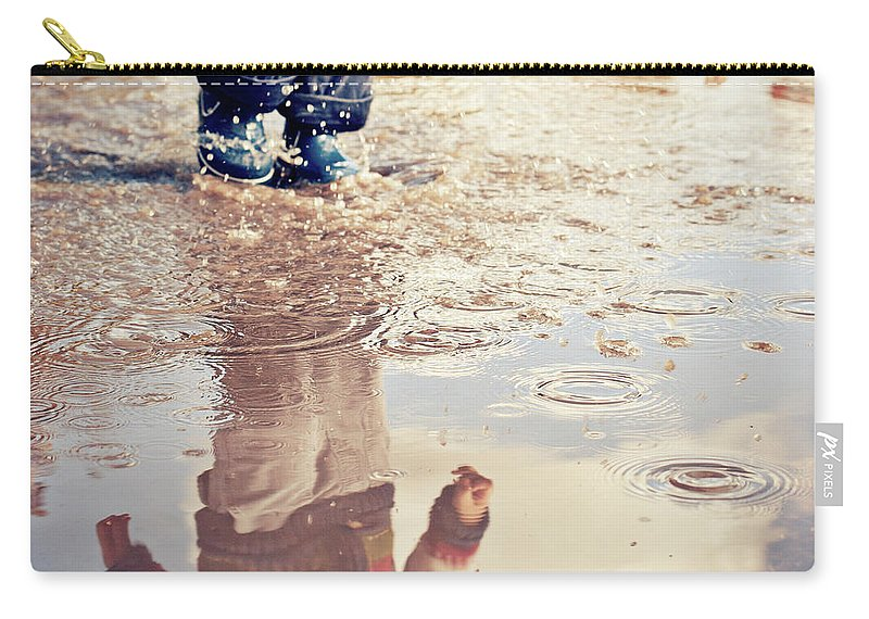 Toddler Carry-all Pouch featuring the photograph Child In A Puddle by Vpopovic