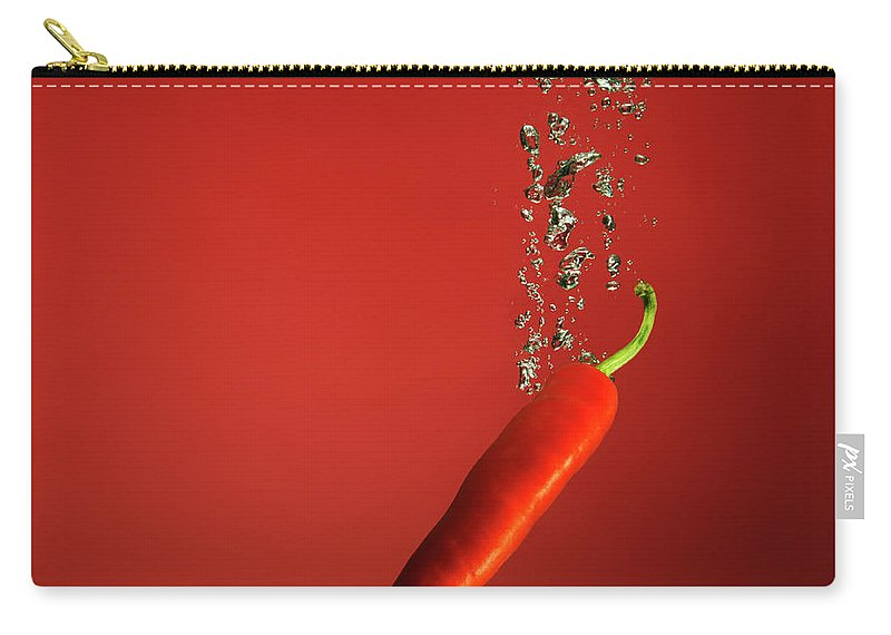 Copenhagen Carry-all Pouch featuring the photograph Chilli Splashed Into Water by Henrik Sorensen