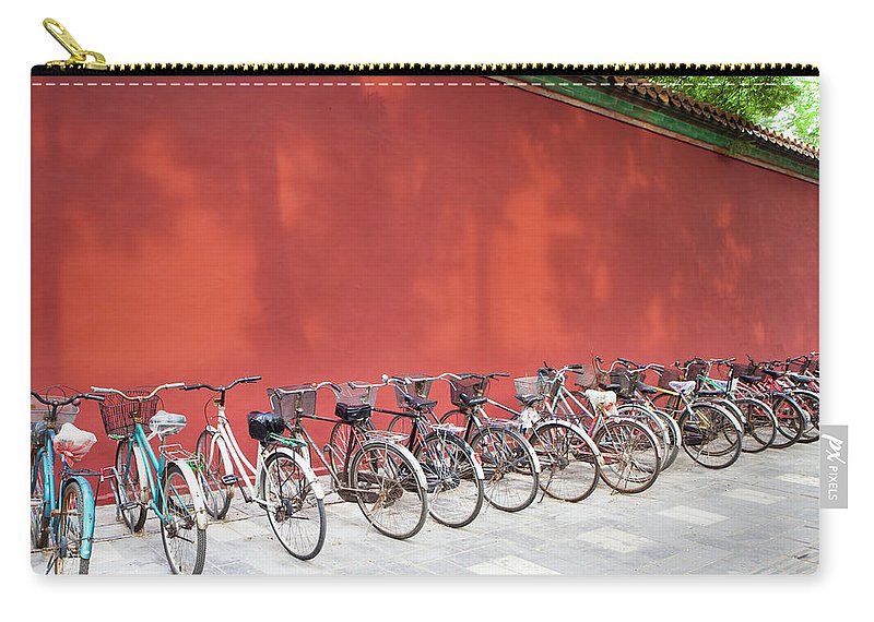 Shadow Carry-all Pouch featuring the photograph Chinese Bikes by Sam Diephuis