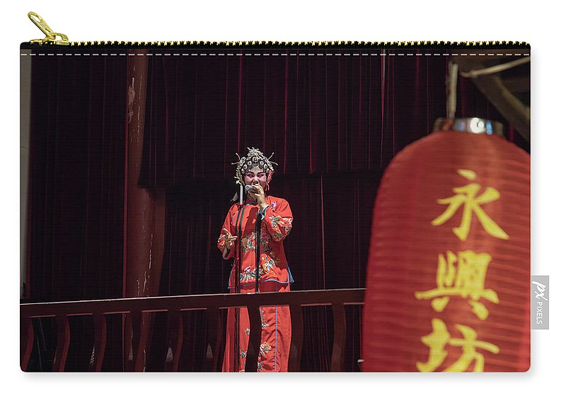 Asia Carry-all Pouch featuring the photograph Chinese Opera Singer Onstage by Karen Foley