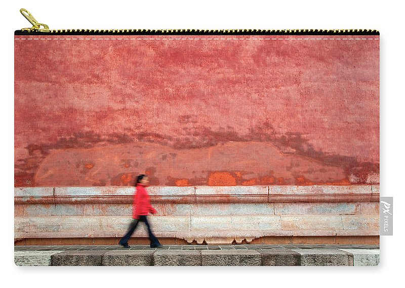 People Carry-all Pouch featuring the photograph Chinese Young Lady Walking By Monument by Grant Faint