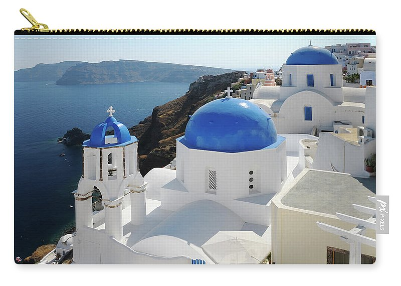 Greek Culture Carry-all Pouch featuring the photograph Churches In Oia, Santorini, Greece by Tunart